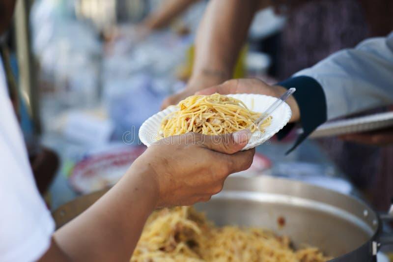 喂养贫寒缓和饥饿 概念产生 库存图片