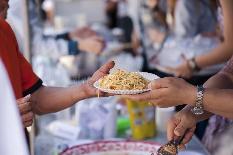 喂养贫寒缓和饥饿 概念产生 免版税库存照片