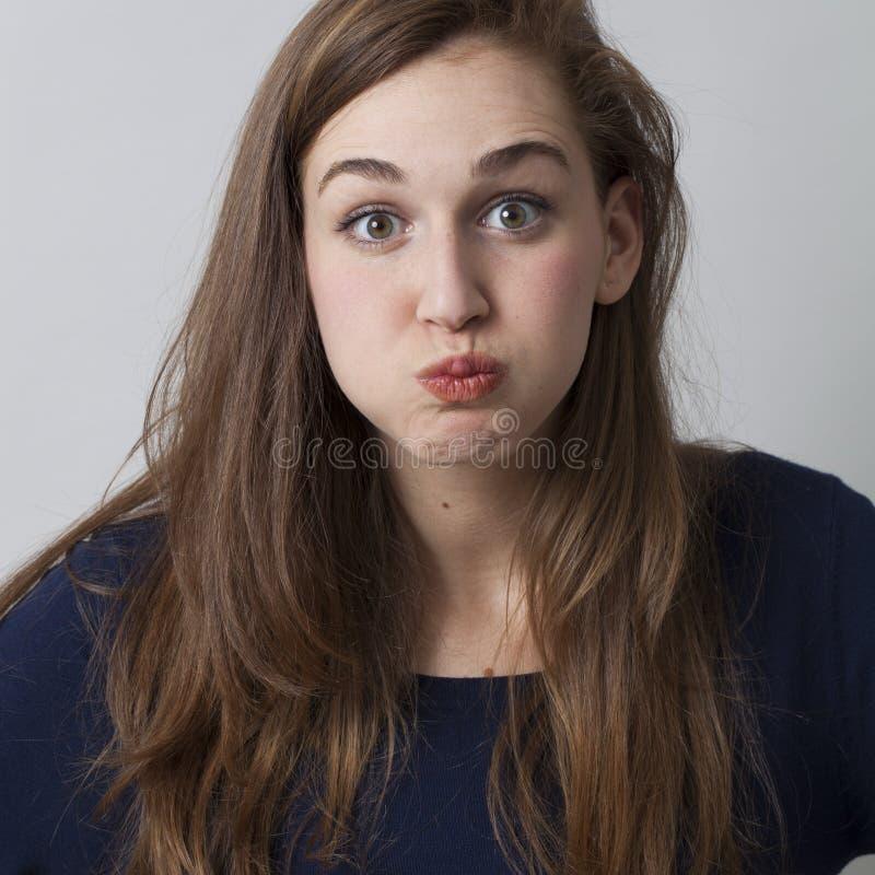 喘气惊奇的美丽的20s的女孩她的面颊  库存照片