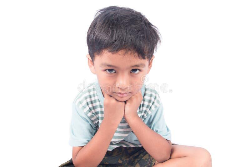 喜怒无常亚裔的小男孩哀伤和 免版税库存图片