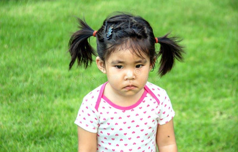 喜怒无常的亚裔女孩 库存图片