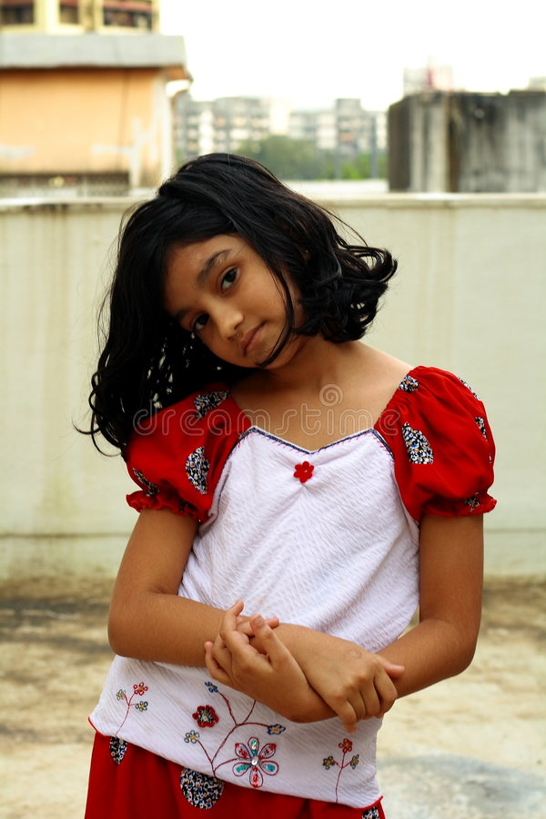 喜怒无常的新亚裔女孩 免版税图库摄影