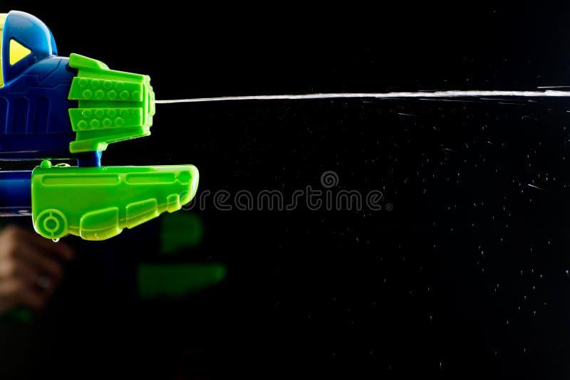 水喷手枪枪射击 免版税库存照片