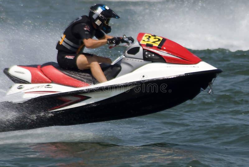喷气机滑雪与小船的驱动器飞行 图库摄影