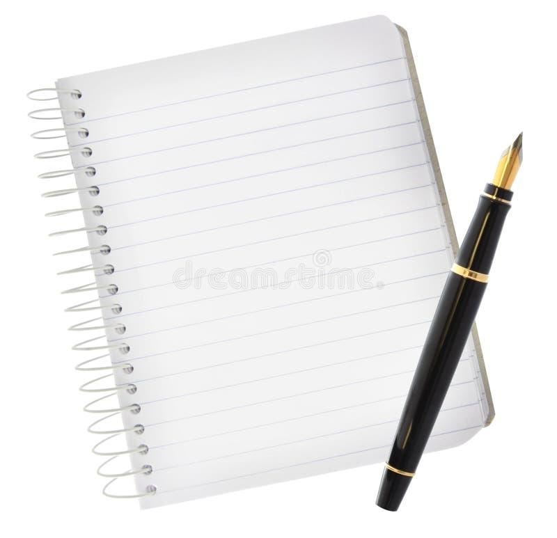 喷泉笔记本笔 免版税库存照片