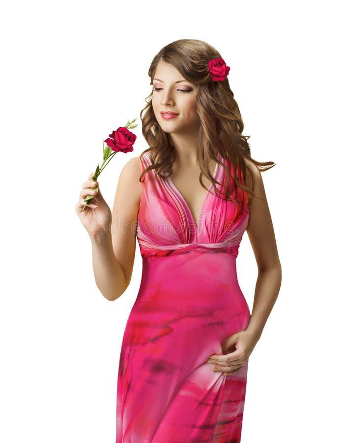 嗅到罗斯花, Spring Portrait,美丽的女孩夫人的妇女 免版税库存图片