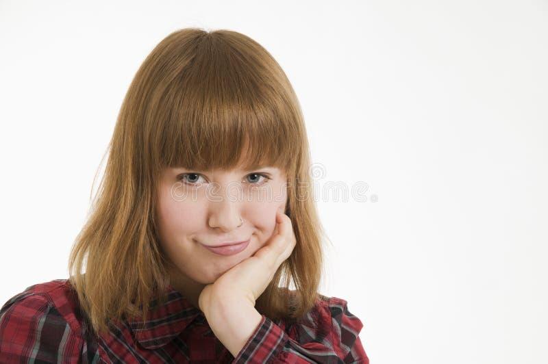 噘嘴的妇女年轻人 免版税库存照片