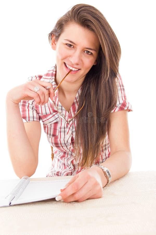 嚼玻璃的甜学生女孩 库存图片