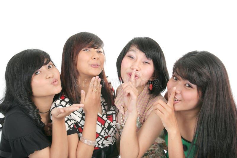 四个女孩诱惑 免版税库存照片