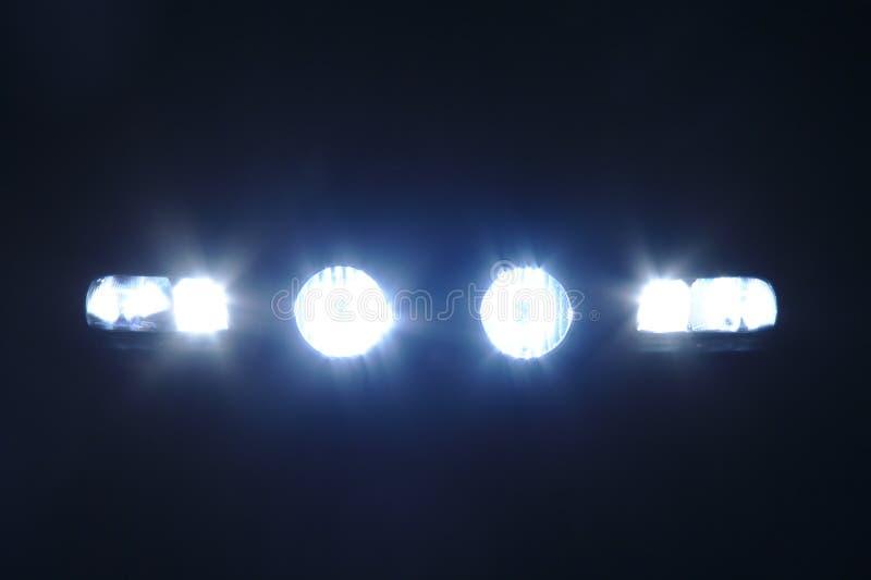 四个明亮的车灯 库存图片