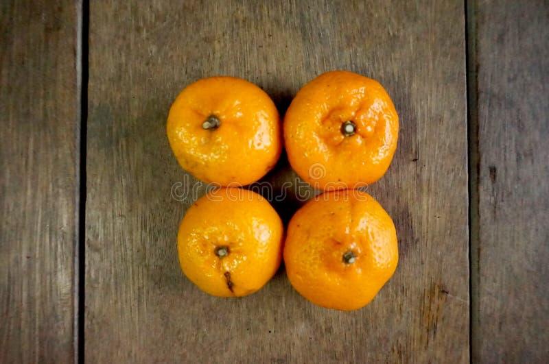 四个橘子 免版税库存照片