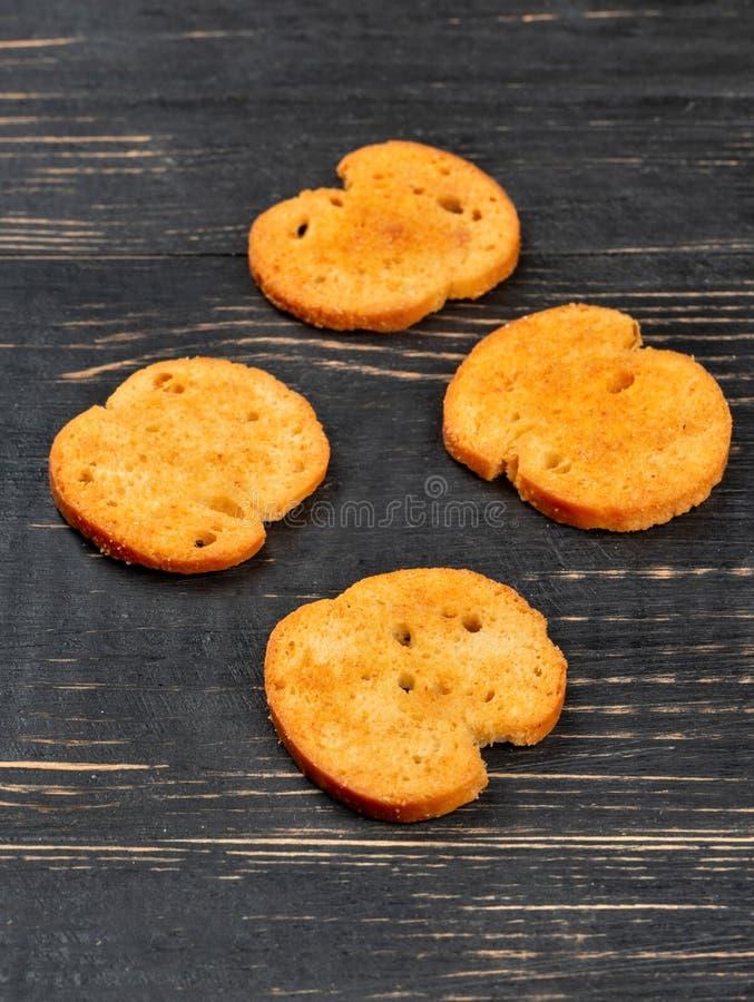 四个油煎方型小面包片bruschetta 库存照片