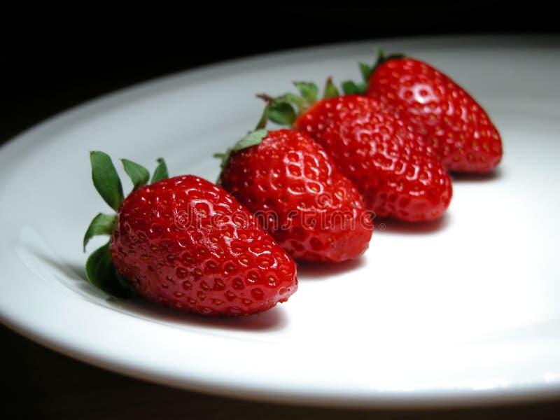 四个草莓 免版税库存图片