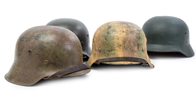 四件德国军队盔甲在白色背景隔绝的二战期间 免版税库存照片