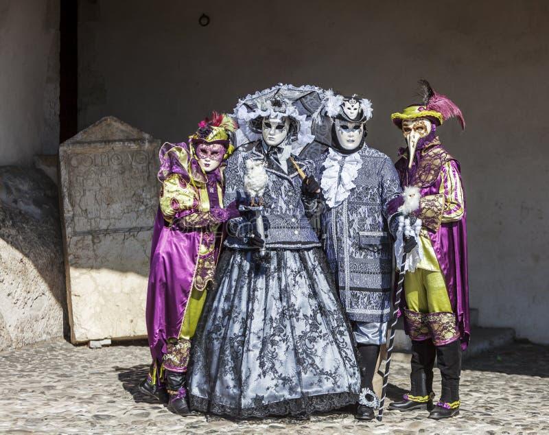 四假装的人-阿讷西威尼斯式狂欢节2014年 免版税图库摄影