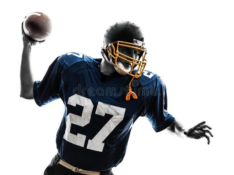 四分卫美国投掷的足球运动员人剪影 免版税图库摄影