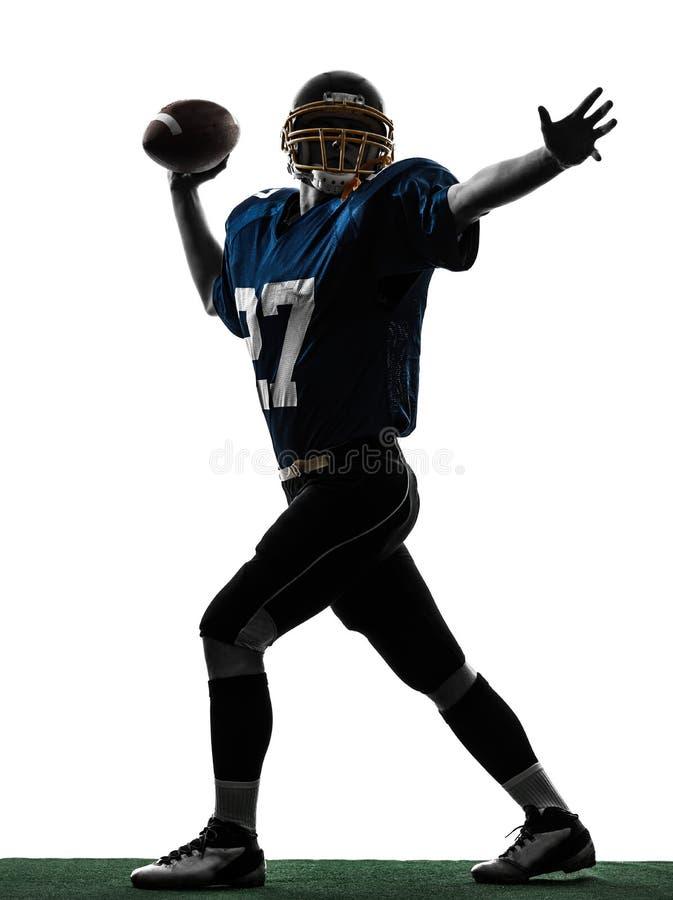 四分卫美国投掷的足球运动员人剪影 免版税库存照片