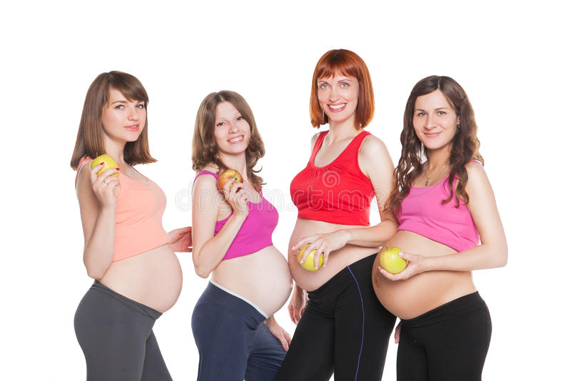 四名愉快的孕妇画象用果子 库存图片