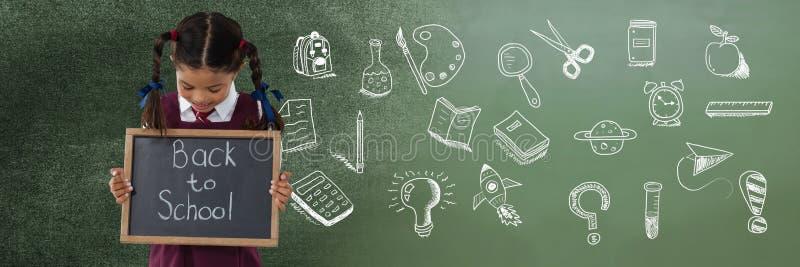 回到与学校女孩和教育图画的学校文字在学校的黑板 库存图片