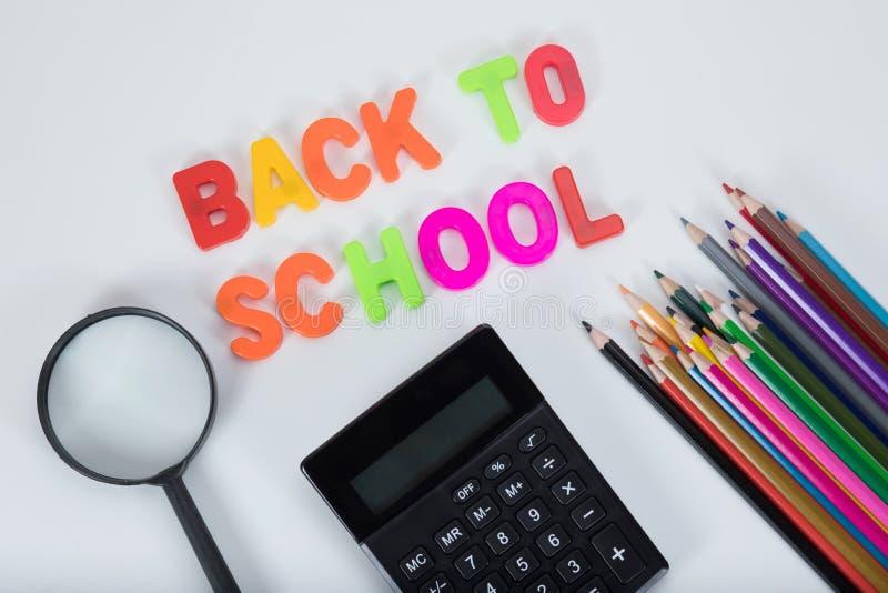 回到学校信件,固定式和供应 免版税库存图片