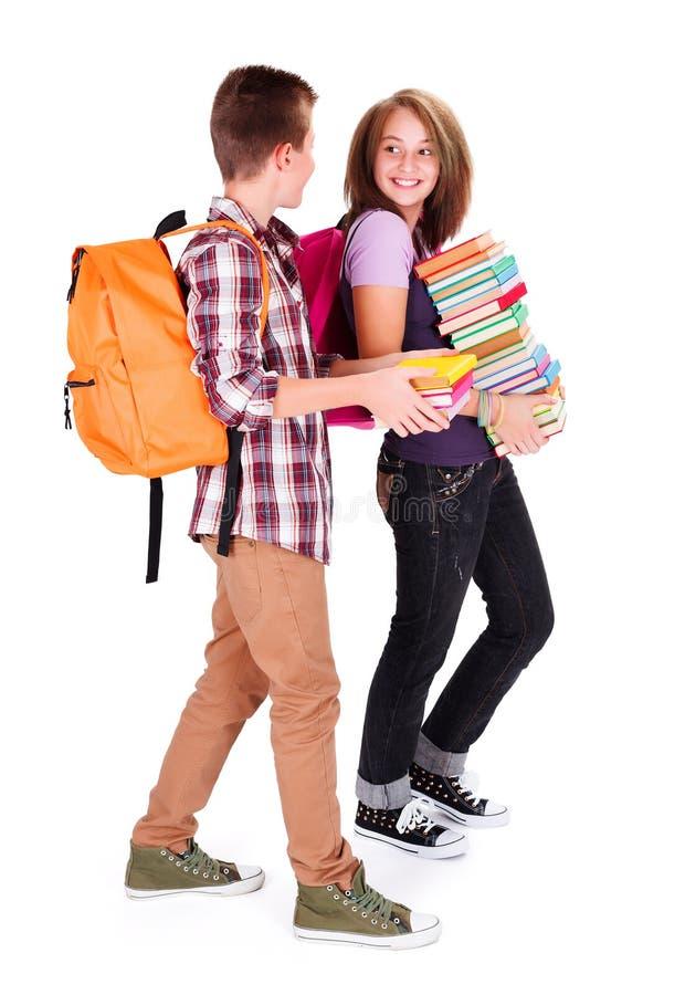 回到学校的聊天的学生 库存照片