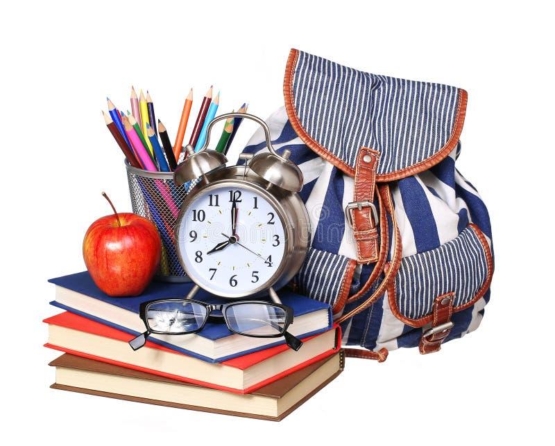 回到概念学校 书,苹果,玻璃,背包 图库摄影