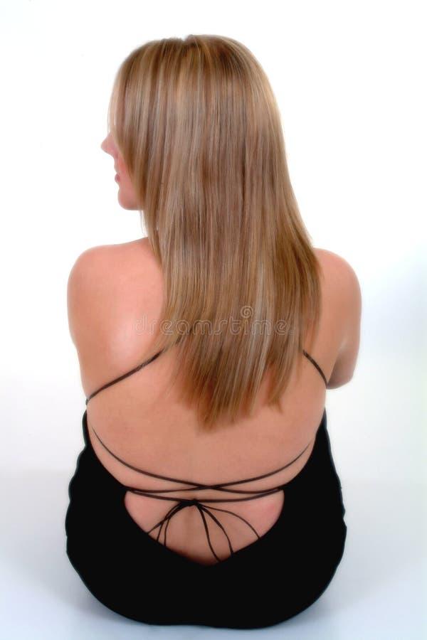 回到白肤金发的女性视图 库存照片