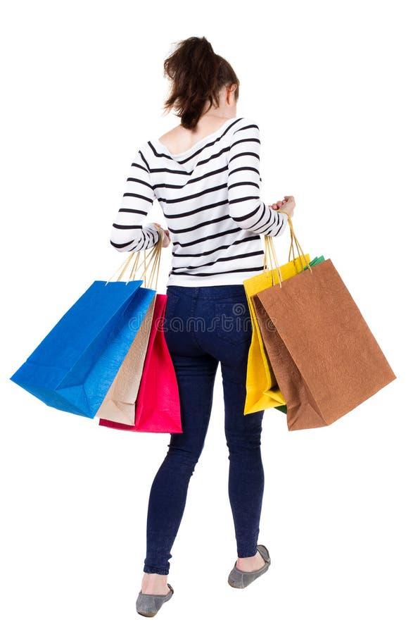 回到观点的有购物袋的去的妇女 美丽的女孩我 图库摄影