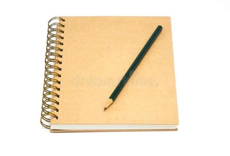 回收包装纸笔记本和铅笔 库存照片