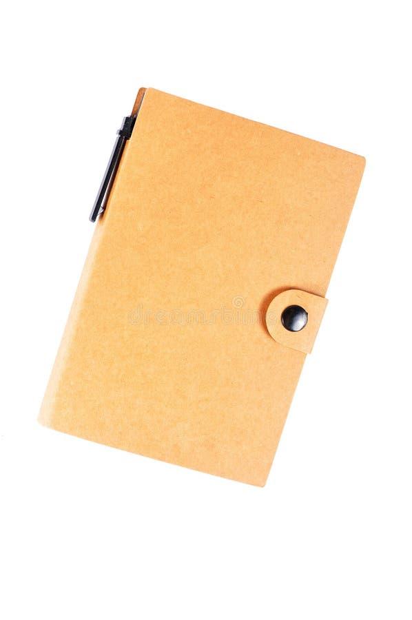 回收在白色背景隔绝的笔记本,棕色盖子 免版税图库摄影