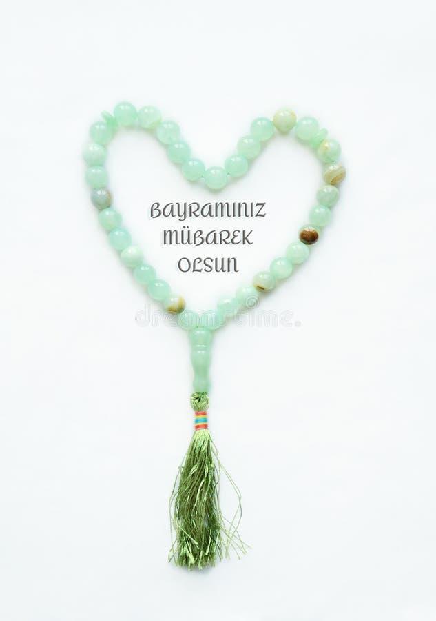 回教念珠,说谎以心脏的形式 题字从土耳其语被翻译到Engllish :保佑您的假日 图库摄影