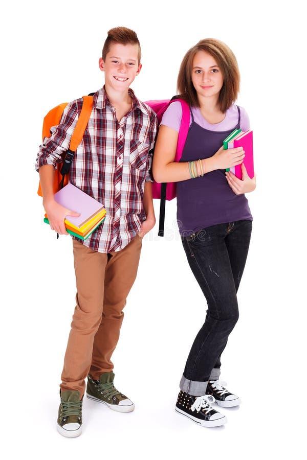回来到学校的青少年的孩子 免版税库存照片
