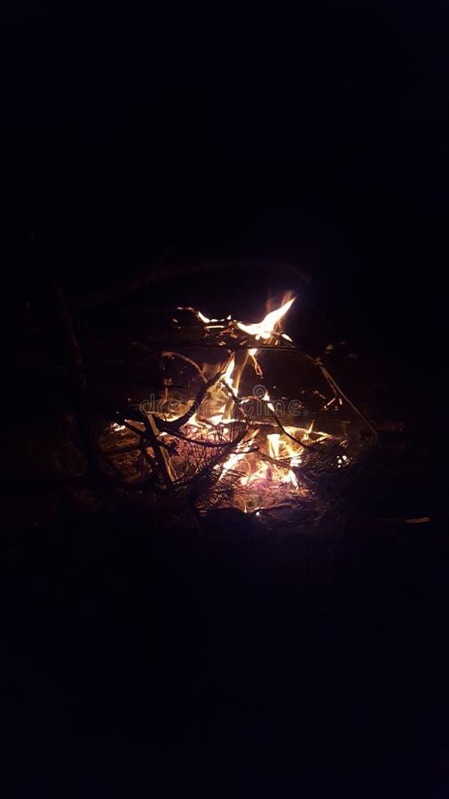 因为背景是使用的美好的罐头火火焰晚上 免版税图库摄影