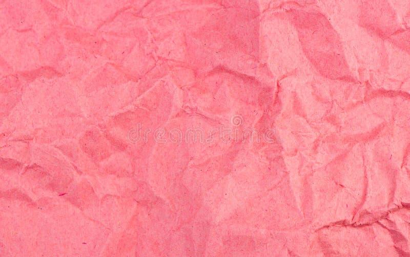 困厄的和被风化的红色纸背景纹理 库存图片