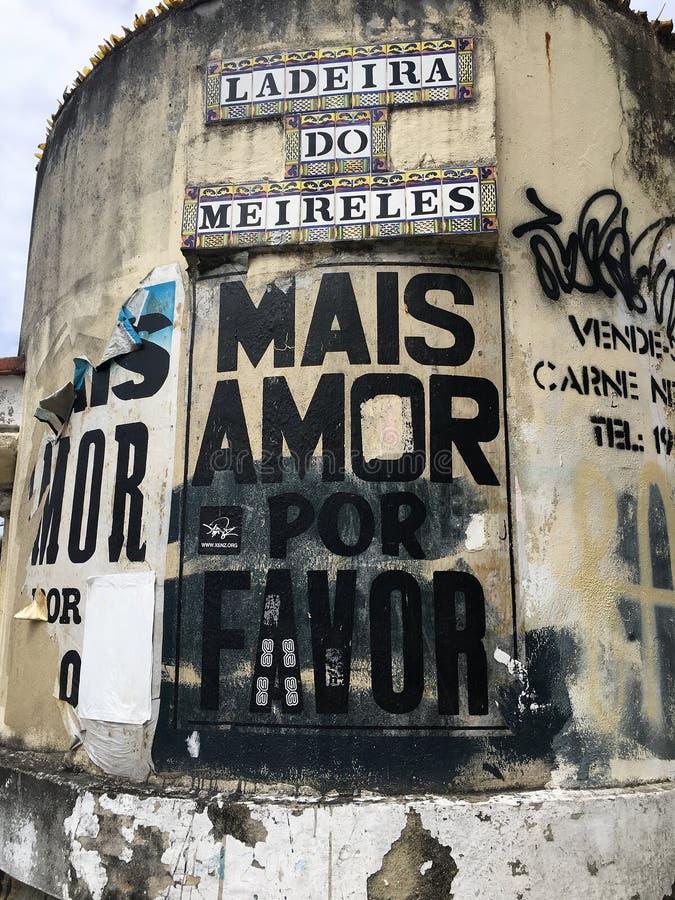 困厄的海报和街道画在Laderia做Meireless,里约热内卢,巴西 免版税库存照片
