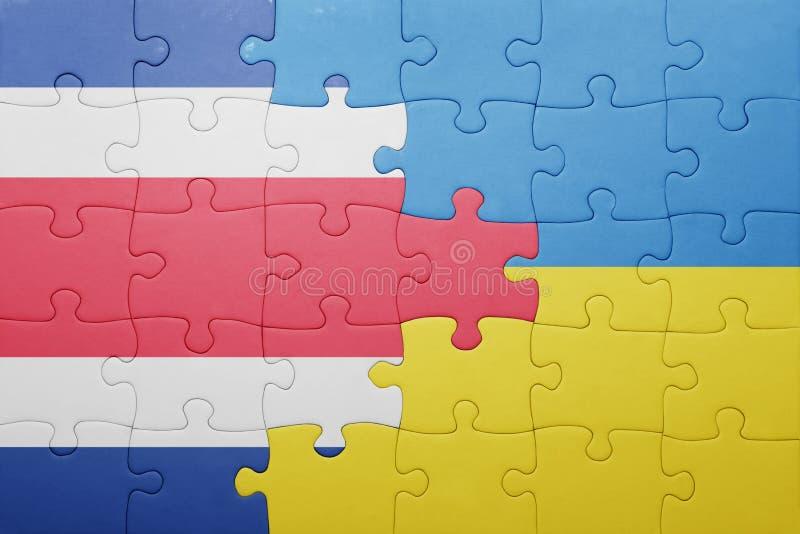 困惑与乌克兰和哥斯达黎加的国旗 免版税库存图片