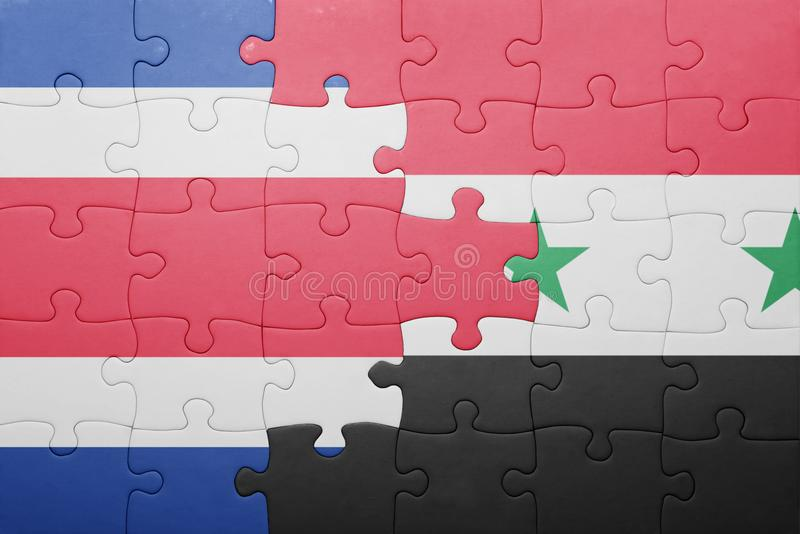 困惑与哥斯达黎加和叙利亚的国旗 图库摄影