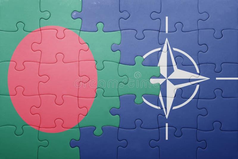 困惑与孟加拉国和北约国旗  库存照片