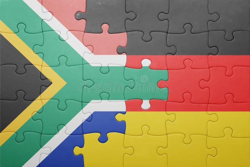 困惑与德国和南非的国旗 库存照片