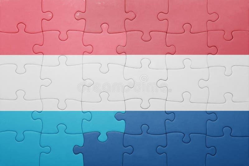 困惑与荷兰和卢森堡的国旗 库存图片