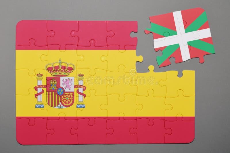 困惑与西班牙和巴斯克地区片断国旗被分开的 免版税库存照片