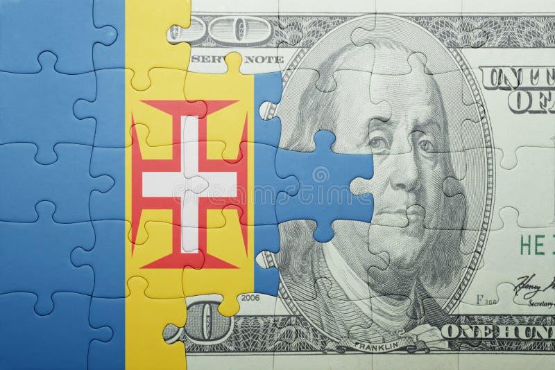 困惑与马德拉岛和美元钞票国旗  免版税库存图片