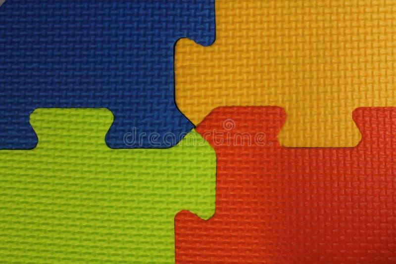 困惑席子,四种颜色橡胶地板摘要背景 库存图片