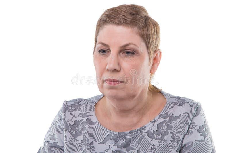 困惑的老妇人画象  免版税库存照片
