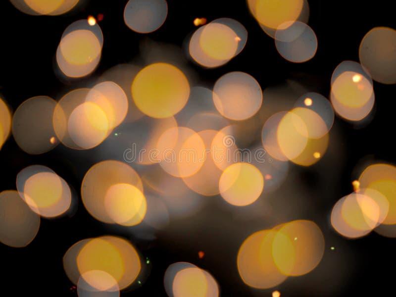 围绕金黄橙色闪耀的被弄脏的光的软的被弄脏的作用 免版税库存图片