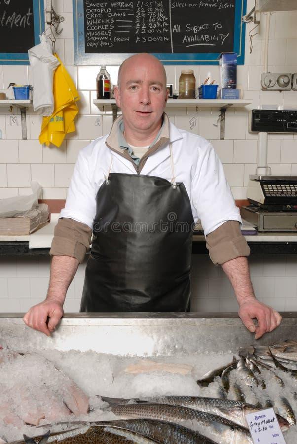 围裙鱼贩子 库存图片