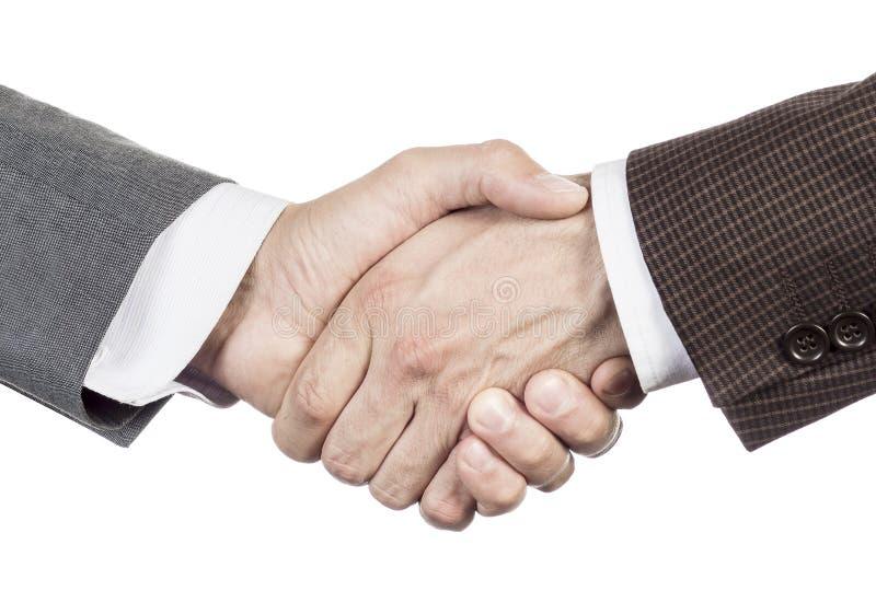 固定信号交换 商务伙伴握手 西装的人们在白色背景做被隔绝的握手特写镜头 免版税库存照片