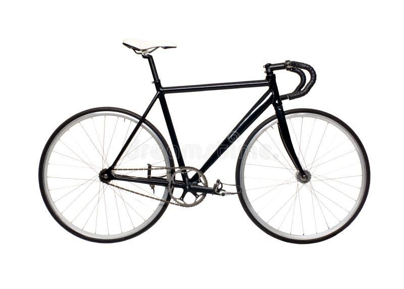 固定的齿轮黑色城市自行车 库存图片