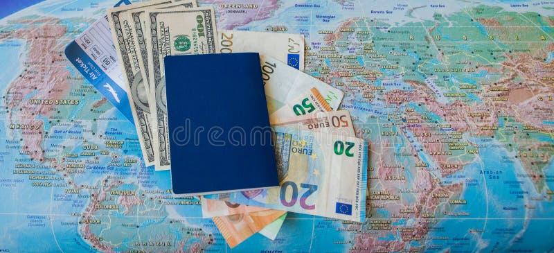 国际旅行concep:护照,票,在地图的金钱 免版税库存照片