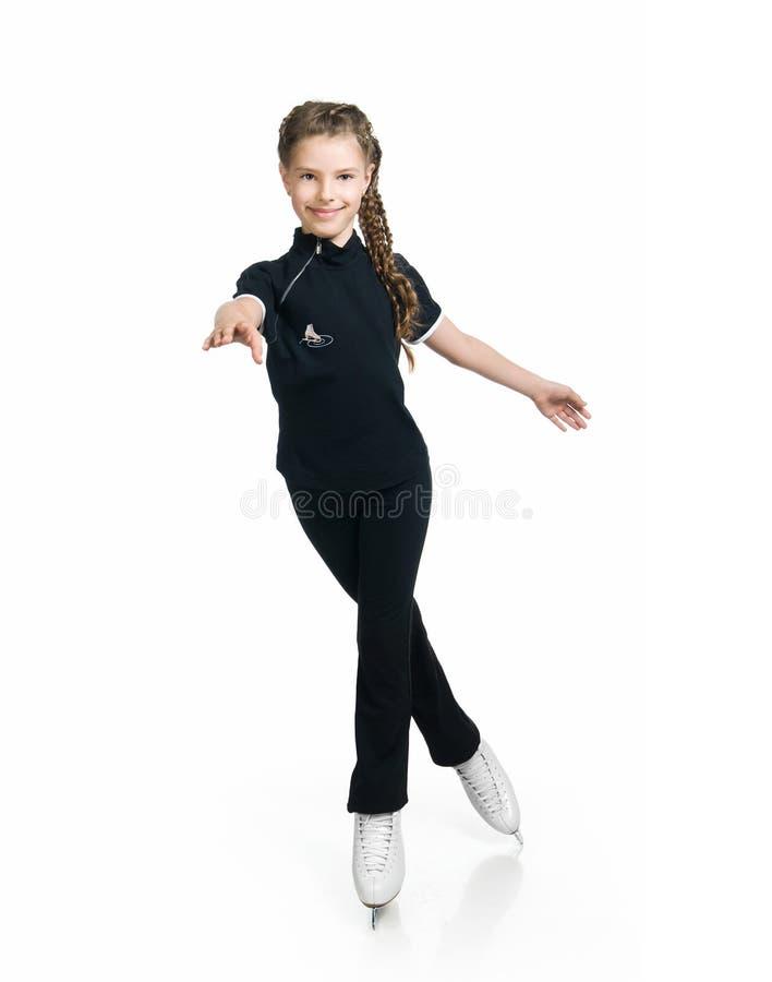 图女孩滑冰的年轻人 图库摄影